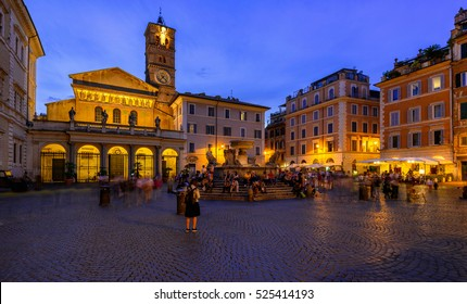 Basilica di Santa Maria in Trastevere and Piazza di Santa Maria in Trastevere at night, Rome, Italy. Trastevere is rione of Rome, on west bank of Tiber in Rome.  Architecture and landmark of Rome.