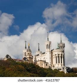 Basilica of Notre-Dame de Fourviere in Lyon, France. Blue Sky, Dramatic Cloudscape.