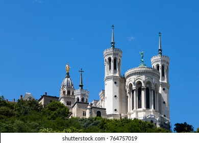 Basilica of Notre-Dame de Fourvière in Lyon, France as seen from below during the summer.