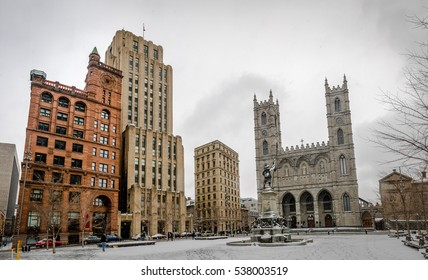 Basilica of Notre-Dame of Montreal and Place d'Armes on snow - Montreal, Quebec, Canada