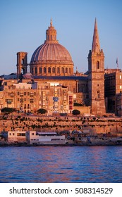 The Basilica of Our Lady of Mount Carmel as seen from Sliema over the Marsamxett Harbour at evening, Valletta, Malta