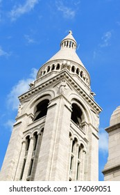 Basilica of the Sacred Heart (Basilique du Sacre-Coeur). It was built between 1873 and 1914 and consecrated in 1919 on Montmartre hill, Paris, France. Detail of the belltower on a summer day.