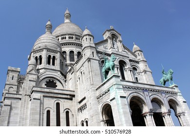 Basilica of the Sacred Heart. Catholic church in Paris, located on the top of the hill of Montmartre, the highest point (130 m) of the city. Summer sunny day. France.