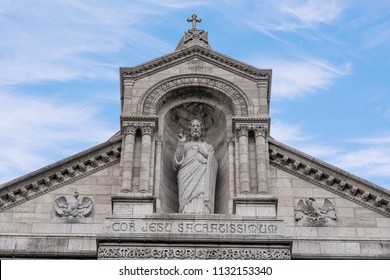 The Basilica of the Sacred Heart of Paris, commonly known as Sacré-Cœur Basilica located on the hill of Montmartre in Paris France. Cor Jesu Sacratissimum translates to the Heart of the World.