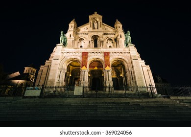 The The Basilica of the Sacred Heart of Paris at night, in Paris, France.