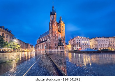Basilica of Saint Mary at dusk with reflection in Krakow, Poland