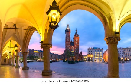 Basilica of Saint Mary on Medieval Main market square as seen from Krakow Cloth Halt at sunset, Krakow, Poland