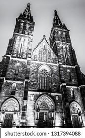Basilica of Saint Peter and Saint Paul, Vysehrad, Prague, Czech republic. Religious architecture. Black and white photo.