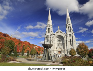Basilica of Sainte-Anne-de-Beaupre with autumn colors on the background