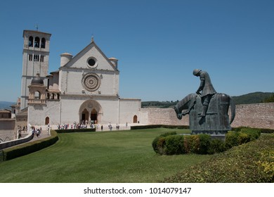 Basilica of San Francesco d'Assisi, facade of the Upper Church with St Francis statue on horse.