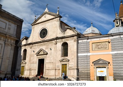 The Basilica of Santa Maria del Popolo in Rome, Italy. It stands on the north side of Piazza del Popolo, one of the most famous squares in the city .