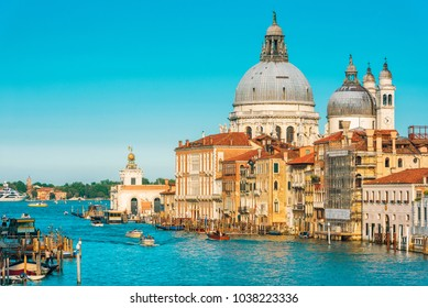 Basilica Santa Maria della Salute on Grand Canal, Venice, Italy. It is a landmark of Venice. Amazing Italian city on the water. Panorama of Venice in summer. Historical houses and cityscape of Venice.