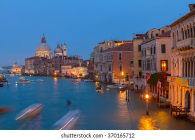 Basilica Santa Maria della Salute and Grand canal embankment at night, Venice, Italy