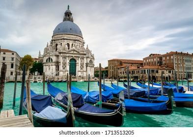 The Basilica of St Mary of Health or Basilica di Santa Maria della Salute at grand canal with gondolas  in Venice, Italy