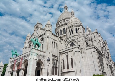 The Basilique Sacre Coeur (Basilica of the Sacred Heart) is a Roman Catholic church and familiar landmark in Paris, located on the highest point of the city in Montmartre.