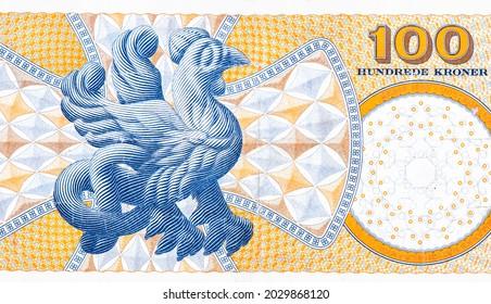 """Basilisk from Tommerby Kirke, a basilisk is part snake, part dragon and part cock. Basilisk means """"little king""""; stylised ornamental cross, Portrait from Denmark 100 Kroner 2003 Banknotes."""