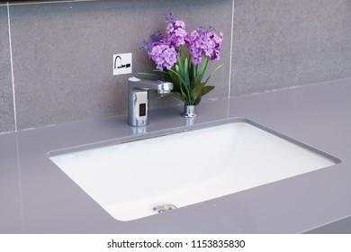 Basin in a modern bathroom. Ceramic wash basin in bathroom.