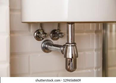 Basin siphon or sink drain in a bathroom, clean