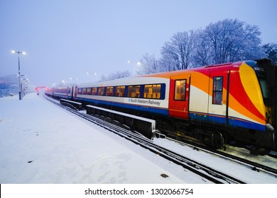 Basingstoke, UK. 1st February 2019. Heavy snow causes major delays to rail transport with South Western Railway seen here.