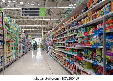 Basingstoke, UK - August 7 2017: RAcks and shelves of baby and infant products for food and hygiene in a large superstore or supermarket