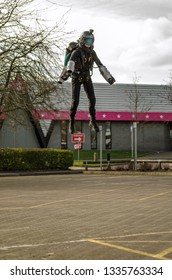 BASINGSTOKE, UK - MARCH 11, 2019:  Gymnast Ryan Hopgood demonstrating a Gravity Industries jet pack by flying over the car park at Basingstoke Leisure Park.