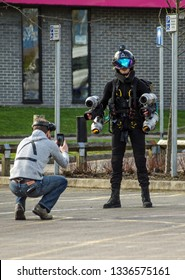 BASINGSTOKE, UK - MARCH 11, 2019:  Founder of Gravity Industries Richard Browning makes final preparations before pilot Ryan Hopgood demonstrates the jet pack he invented by flying above the ground.