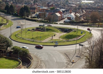 BASINGSTOKE, UK - MARCH 7, 2007:  Cars and pedestrians navigating the Victory Roundabout in the middle of Basingstoke town in Hampshire on a sunny spring morning.