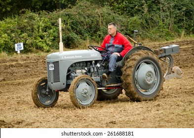 BASINGSTOKE, UK - OCTOBER 12, 2014: Farmer Christopher Rainthorpe driving a vintage Ferguson TEF20 tractor during the British National Ploughing Championships, 2014.