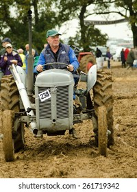 BASINGSTOKE, UK - OCTOBER 12, 2014:  Farmer Eifion Evans driving a vintage Ferguson TEA20 tractor after competing in the British National Ploughing Championships, 2014. Accredited photographer