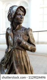Basingstoke, United Kingdom - July 05 2018:   A statue of Jane Austen in Market Place, sculpted by Sculptor Adam Roud and unveiled in July 2017
