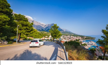Baska Voda, Croatia,  24 August, 2019: Car on road to Riviera Makarska, people in travel to Baska Voda. Croatia.