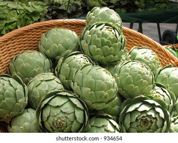 Basket of artichokes in outdoor market in Paris