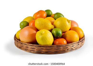 Basket with assorted citrus fruits on a white background