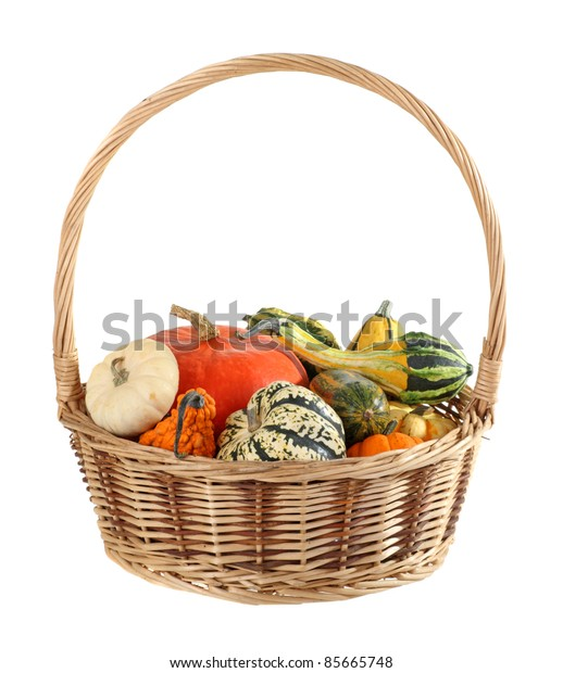 Basket of assorted colorful gourds isolated on white