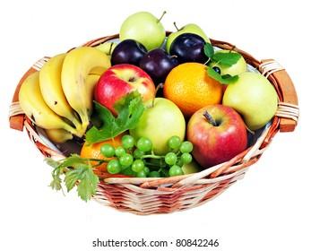 Basket of assorted fresh fruit isolated over white