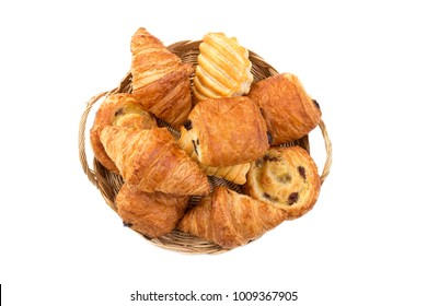basket of assortment of pastries breakfast food on white
