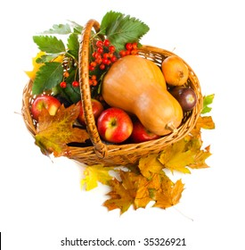 Basket with autumnal fruit and vegetables, shot from top
