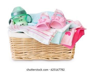 Basket of baby clothes isolated on white.Newborn loundry.