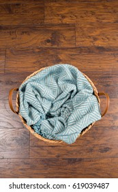Basket with a blanket inside awaiting a newborn baby during a studio photo session by a professional photographer.