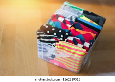 Basket or box with neatly folded colorful socks. Socks or clothes organization and sorting method.