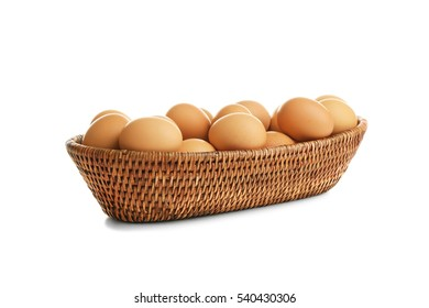 Basket with brown eggs on white background