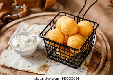 basket of cheese balls on wooden plate