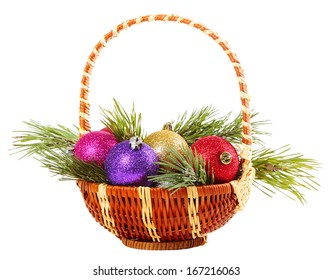 Basket with Christmas baubles on a white background
