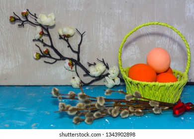 basket with colored eggs and willow twig