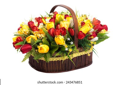 Basket with colorful bouquets of tulips on white background