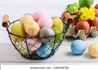 Basket of colorful Easter eggs.