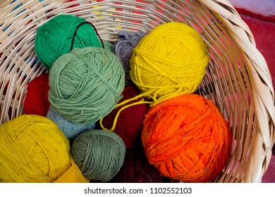 Basket of colorful, natually died wools of Peru