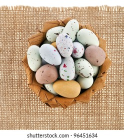 Basket with colorful spotted egg , easter card border on a white background