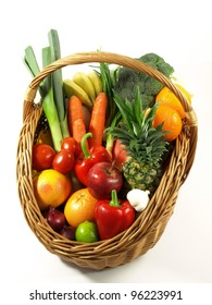 Basket with colorful vegetables and fruits on isolated background.