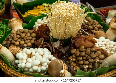 A basket containing of variety edible mushrooms; consist of the golden needle mushroom, King Oyster Mushroom, Jelly ear or Jew's ear, White beech mushroom, Yanagi Mutsutake, shiitake mushroom